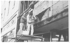 Don Martell and John Schmid working on the renovation of 21 Haywood, converted to provide street level retail and residential condominiums on upper floors.